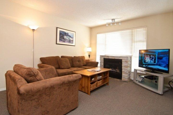 Spacious Living room with big screen TV, Sofa bed and fireplace - Glacier Lodge remodeled 2 bed condo facing interior courtyard and pool. Sleeps - Whistler - rentals