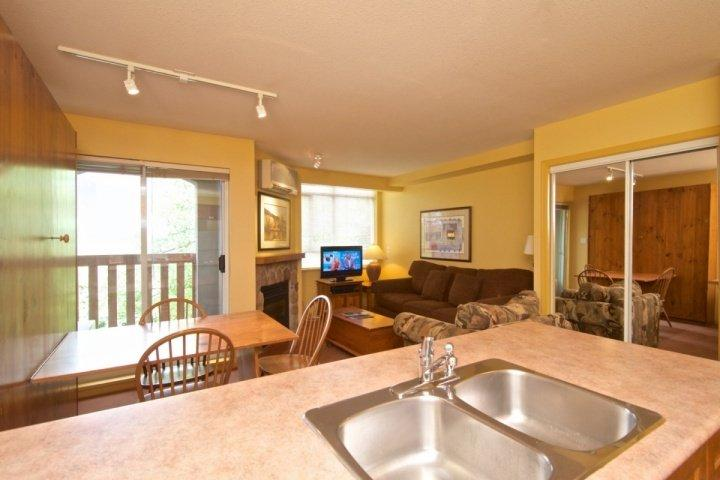 View from Kitchen into living space, great floor plan - Lovely Studio Condo at Deer Lodge - Whistler - rentals