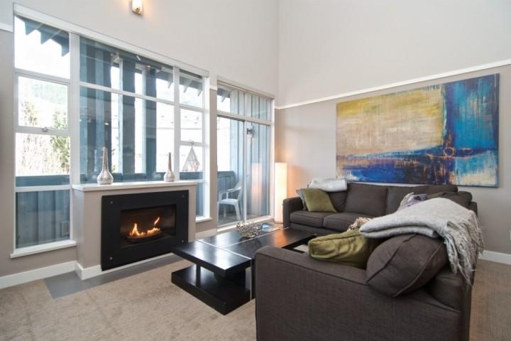 Spectacular grand living room, vaulted ceilings, plenty of natural light, custom art work and modern decor - Glacier Lodge 3 bedroom unit 320 - Whistler - rentals