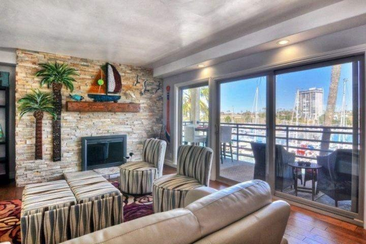 Living room with harbor views - Harbor View Penthouse 402B - Oceanside - rentals