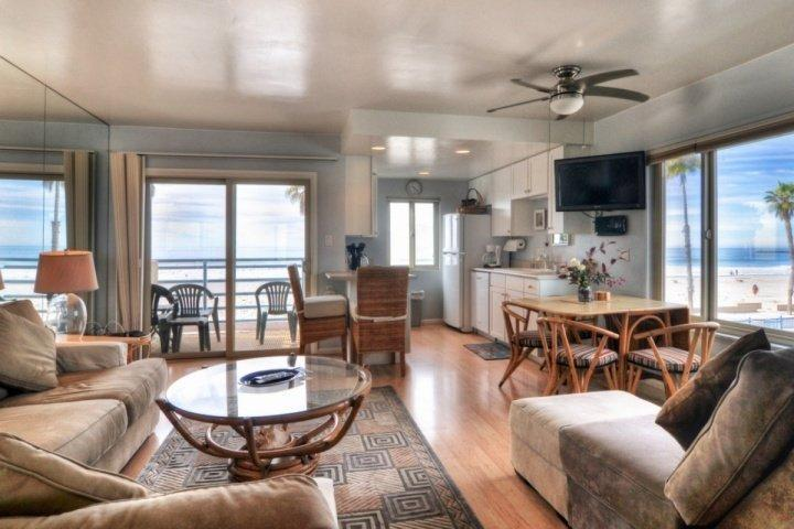 Living room, dining area, kitchen, view of patio and beach views. - Marina Del Mar 301A - Beach & Ocean View - Oceanside - rentals