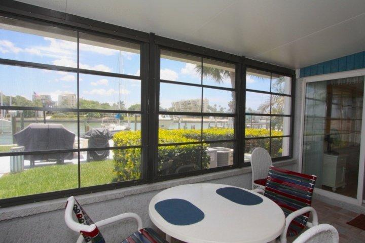 Indoor/Outdoor dining area with a waterfront view - 315-B - Madeira Beach Yacht Club - Madeira Beach - rentals