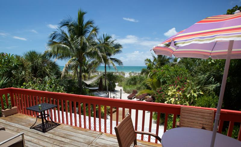 "Charming Gulffront ""on the beach"" Coquina Cottage and amazing tropical beach gardens. - Image 1 - Captiva Island - rentals"