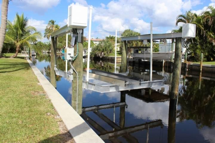 Newly installed boat lift on canal behind house - Canal Front Bokeelia Fishing Bungalow - Bokeelia - rentals