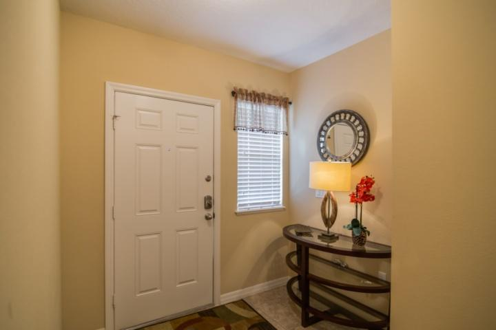 Tiled Foyer w/Table & Decorations - 9047 Calabria - Four Corners - rentals