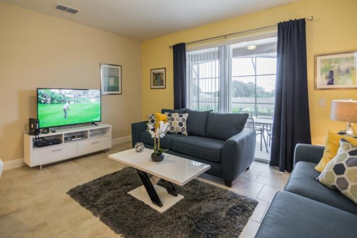 Living Area w/Flat Screen TV & Pool Access - View #2 - 5360 Solterra - Davenport - rentals