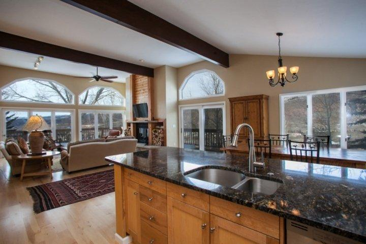 Open floor plan with upgraded kitchen, bright living room and large dining table for 6. - Bright, Open Eagle Vail Home, Mtn Views, Beautifully Remodeled, Convenient to - Minturn - rentals