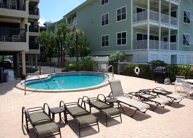 Pool, sun deck and BBQ area - Relax by the Seashore in this Fabulous cottage styled condo by the sea - Indian Rocks Beach - rentals