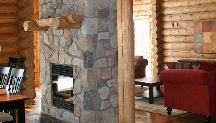 This eye-catching, log-burning fireplace is a centre piece in the living/dining area - Mont Tremblant Blueberry Lake 4 Bedroom 3 Bathroom Chalet - Labelle - rentals
