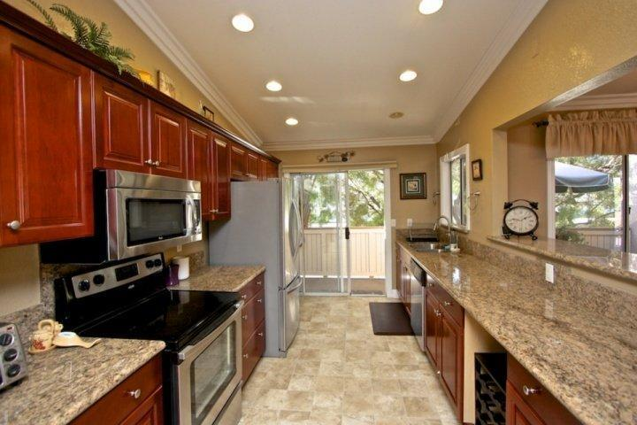 Highly upgraded kitchen with cherry cabinetry, granite counters, and stainless appliances - Monarch Beach Condo at Ritz Pointe - Dana Point - rentals