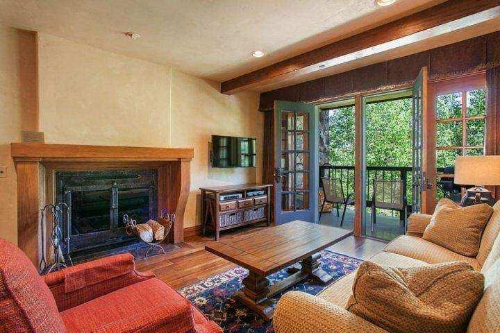 Listen to the flowing creek in this beautiful sunken living room with wood fireplace, flat screen TV and DVD player. - Heart of Beaver Creek~ Outdoor Hot Tub~ Balcony & Views of creek! Beautiful! - Avon - rentals