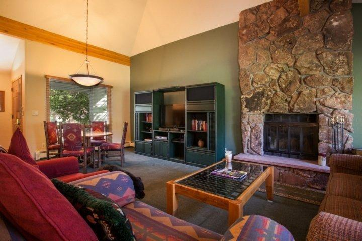 Inviting living area with flat screen tv, wood burning fire place and game table for 4. - Eagle-Vail Duplex, Nordic Trails in Winter, Biking Trails in Summer, Convenient to Vail or BC! - Eagle-Vail - rentals