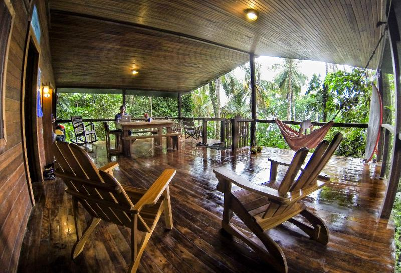 Main porch and entry elevated into the canopy of the jungle- No vehicle access to property. - Coral Reef House- located on the Beach - Manzanillo - rentals