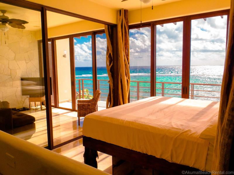 View from master bathroom overlooking master BR and sliding door to living room. - Akumal Beachfront Penthouse w/Infinity Pool, Nahil - Akumal - rentals
