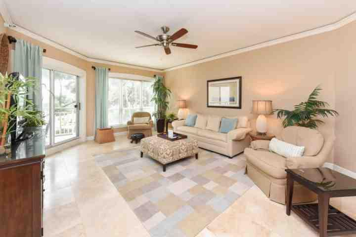 Family Room with Ocean Views and Sliding door to Balcony - Luxurious Ocean View - Professionally Decorated 1BR/2BA Windsor Place  - A Few Steps to the Ocean - Hilton Head - rentals