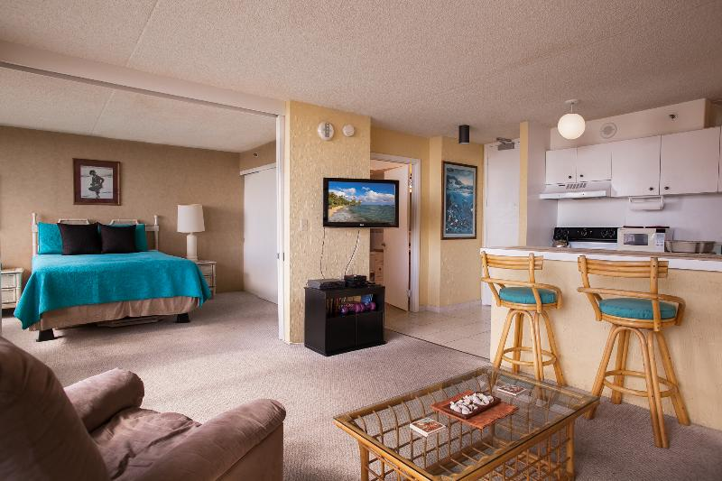 Living room, and bedroom in back, wall mount TV. - 1BR LARGE Waikiki 1 BDRM Ocean Views Pool WB 3406 - Honolulu - rentals