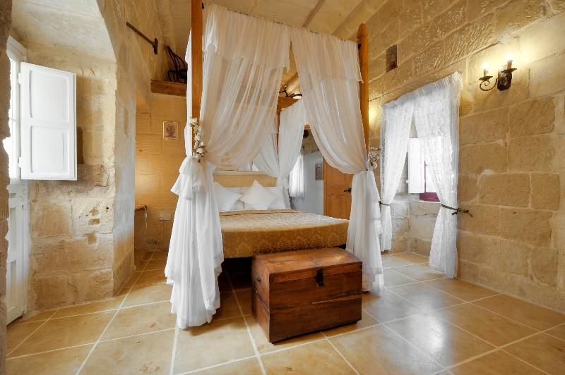 main double bedroom with en-suite; having also a safe-deposit box.  Window overlooking the pool - Tal-Barun Farmhouse. - San Lawrenz - rentals