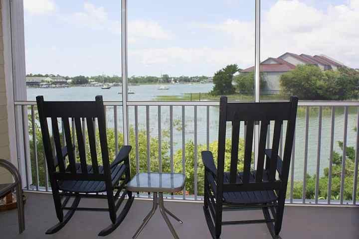 Screened Porch for relaxing and Catching the Breeze - Spacious, clean and comfortable 3 BD/3 BA Sleeps 6-8 Marsh View Condo-With Pool - Folly Beach - rentals