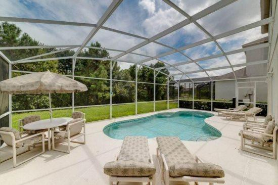 Spacious 4 Bedroom Pool Home with Conservation View. 148FVD - Image 1 - Kissimmee - rentals