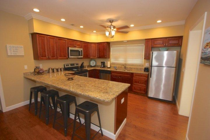Fully Equipped and Updated Kitchen with Granite Counter Tops/Stainless Steel Appliances-Perfect for Meals Large and Small - 402  Happy Fiddler - Indian Rocks Beach - rentals