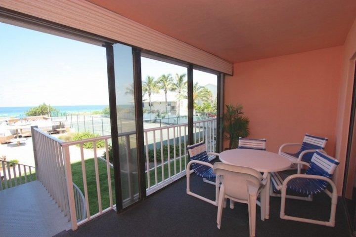 Private Patio overlooking the Heated Pool/Tennis Courts and Amazing Gulf View-Patio Seating for 4-6 - 108 Reef Club - Indian Rocks Beach - rentals