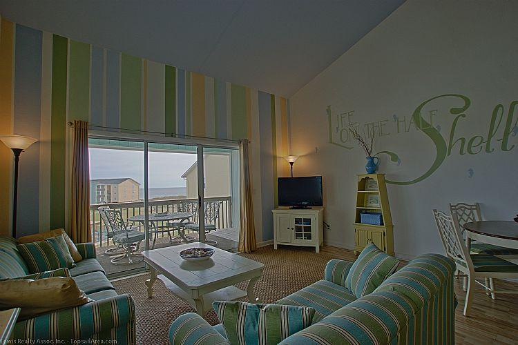 Living Room - Surf Condo 332 - Magnificent Ocean View, Coastal Decor, Pool, Beach Access, Onsite Laundry - Surf City - rentals