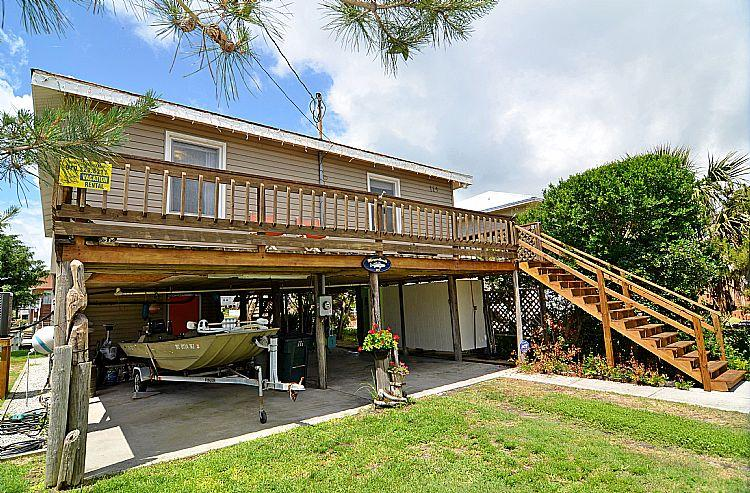 Exterior from Street - Margaritaville - Delightful Cottage, Canal Front, Dock, Ocean & Sound Access - Topsail Beach - rentals