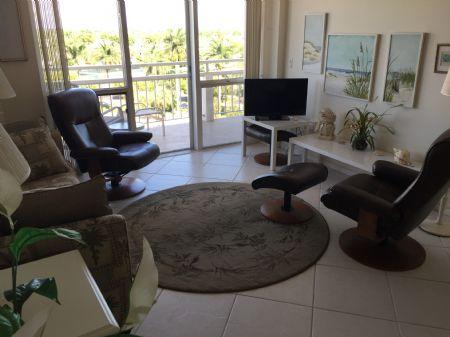Living Room - Lovely 1 bedroom beachfront condo walking distance to famous Island dining venues ! - Marco Island - rentals