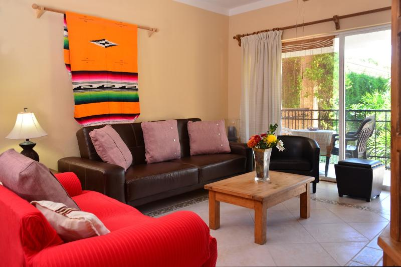 Living area with lots of comfortable seating. - RINCONADA DEL SOL 212; great location, great rates - Playa del Carmen - rentals