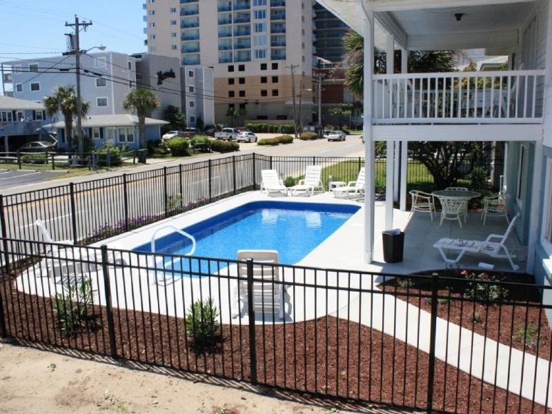 Beautiful beach house on Ocean Blvd. Partial ocean view from the upper porch - Across from Beach/Private Pool! 7 bd/4ba - North Myrtle Beach - rentals