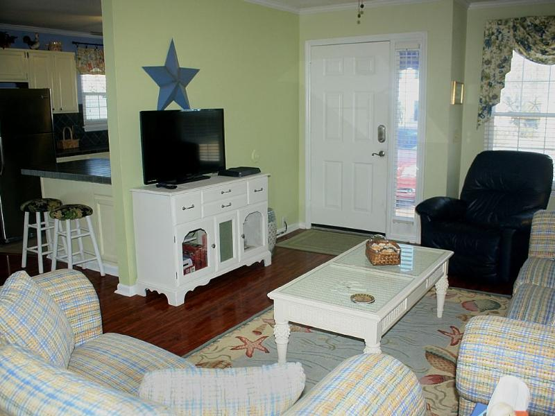 Spacious living room with comfortable seating, flat screen and DVD player. - Wonderful Rates! Charming 2 story House, Private - North Myrtle Beach - rentals