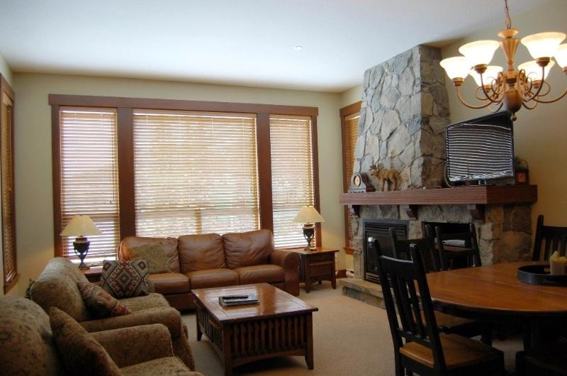 Warm, inviting fireplace and cozy living area - Big White Stonebridge Lodge 3 Bedroom Condo with Private Hot Tub - Big White - rentals