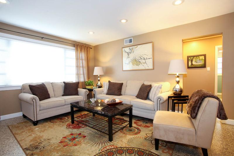 Living Room has a queen sized sleeper sofa. - Large Uptown Condo W/Pking-Easy Access to All NOLA - New Orleans - rentals