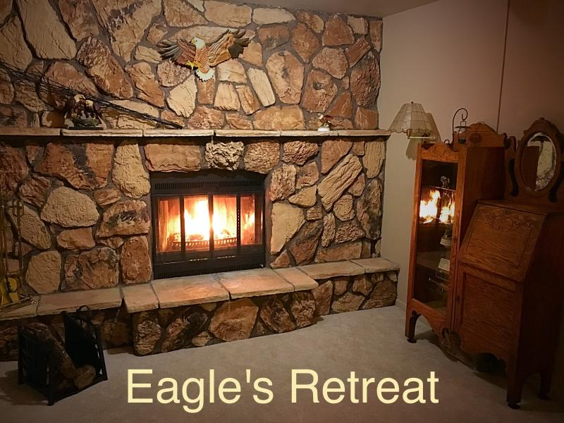 "This custom wood-burning fireplace is the perfect place to relax after a day of exploring - ""Eagle's Retreat"" Gorgeous Park and Lake Views - Gladstone - rentals"