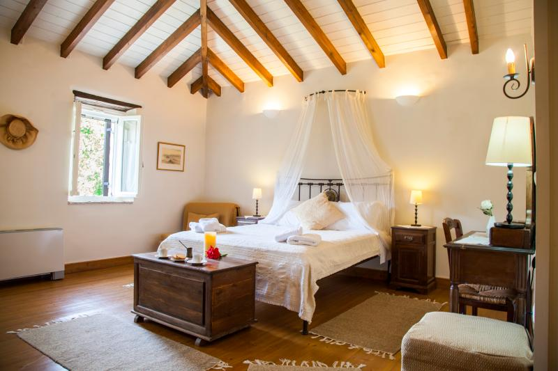 Spacious master bedroom with exposed beams - Charming Historic Villa MELI close to BEST beaches - Lefkas - rentals