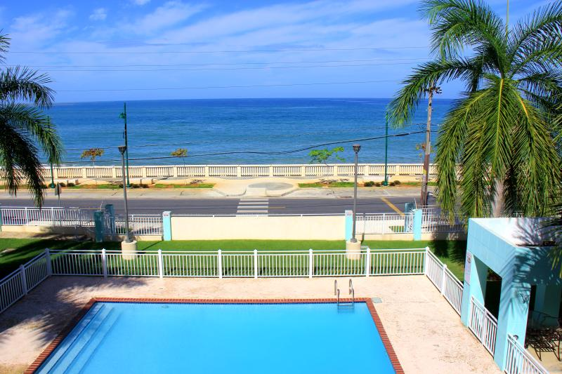 Balcony View: Ocean, Pool, and Paseo Real Marina. - Ocean Front Condo in Aguadilla North West P.R. - Aguadilla - rentals