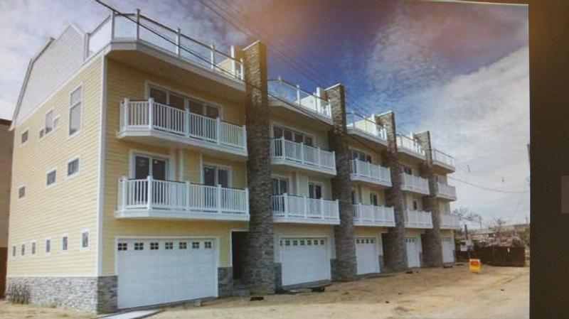 The unit., 2nd from left, is the entire unit, with 2 balconies and a full roof deck - Luxory Townhouse, 1 Block From The Beach - Seaside Heights - rentals