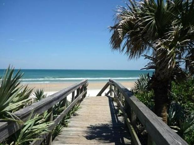 Walkway to the beautiful white sandy beach - Award Winner ! Beautiful 3/2 Condo - New Smyrna Beach - rentals