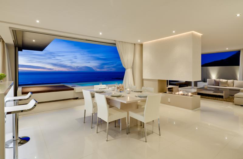 Dining room with gas fireplace - Spectacular Aquatic Penthouse, Walk to Beach - Camps Bay - rentals