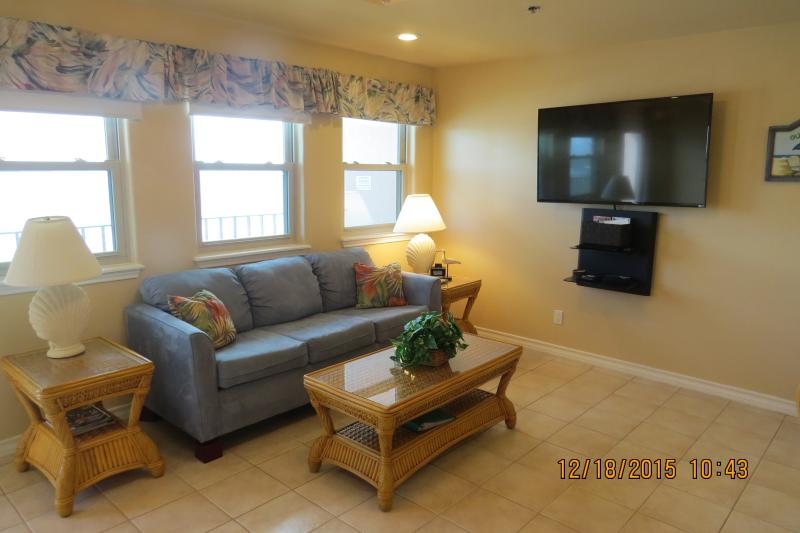 One of two couches in Living room with a 55 inch Smart TV - Large 3 Bedroom Beachfront Condo - South Padre Island - rentals