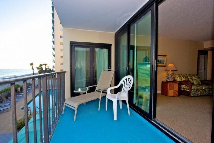 Enjoy the beach from your first floor balcony, one story above the ground. - Horizon East 103 - Garden City Beach - rentals