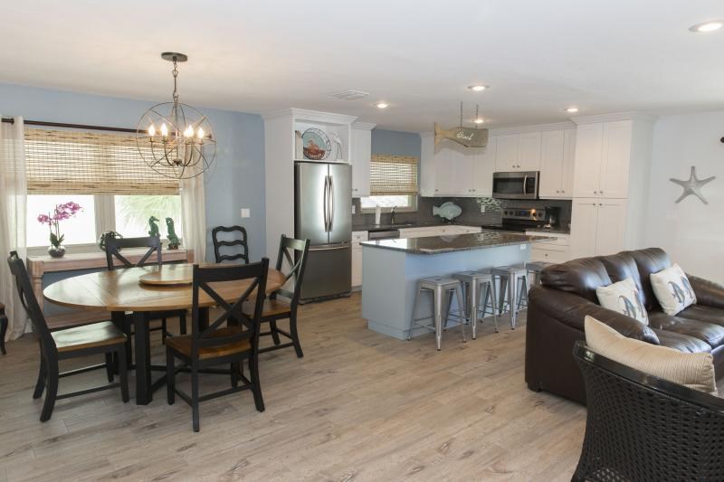 Large living area that is 700 sq. ft., great for entertaining and togetherness. - Siesta Beach is only a half a block! Sleeps 6-8. - Siesta Key - rentals