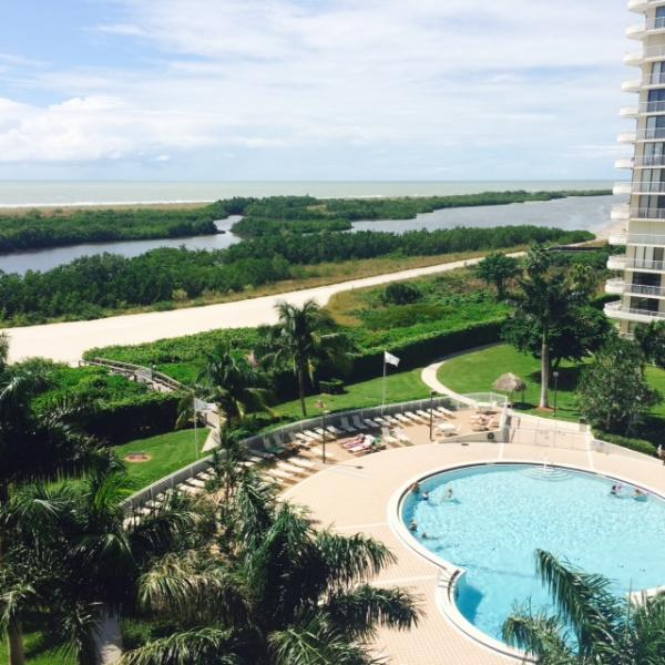 Stunning view of the pool, gulf access and beach from our lanai. - Stunning Beachfront Condo in Gated Community - Marco Island - rentals