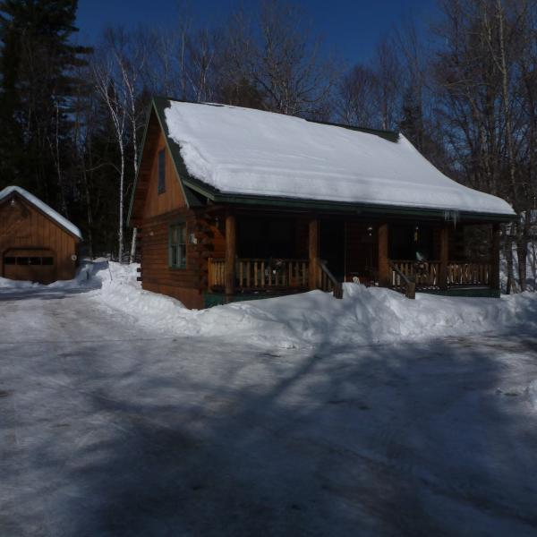 A picture taken in the Winter of the house (right) and bunkhouse (left) - Greenville Log Cabin w/ Bunkhouse - Greenville Junction - rentals