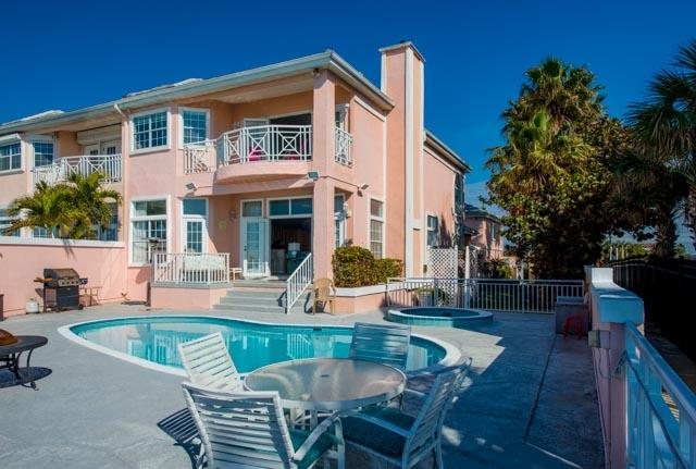The Pink Palace, pool and Spa deck as seen from the beach - Beachfront Townhome-private heated pool 85 degrees - Belleair Beach - rentals
