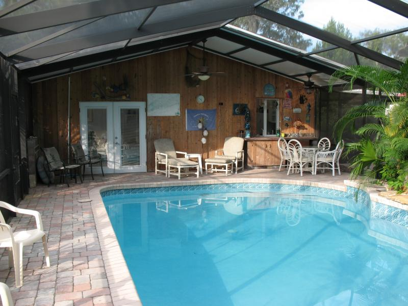 solar heated pool - pool home, tropical setting - Ormond Beach - rentals
