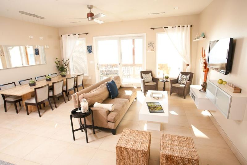 Living & Dining Area - Awesome 6 Bedroom 6 1/2 Bath Condo on the Bay! - South Padre Island - rentals