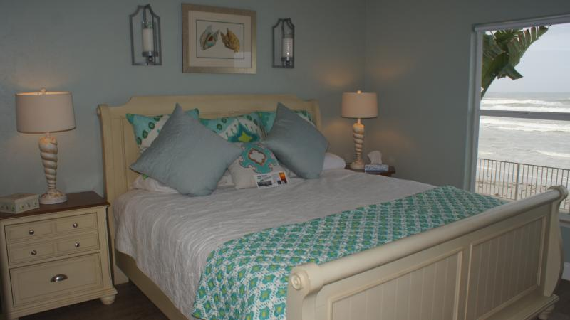 "King bed in master bedroom with door to first floor oceanfront patio! - Oceanfront first floor non-driving beach 55"" HDTV - New Smyrna Beach - rentals"