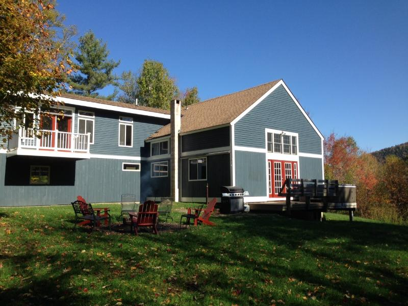 Backyard with fire pit and wood shed. - Secluded Killington 6 Acre Scenic Mountain View Pr - Killington - rentals