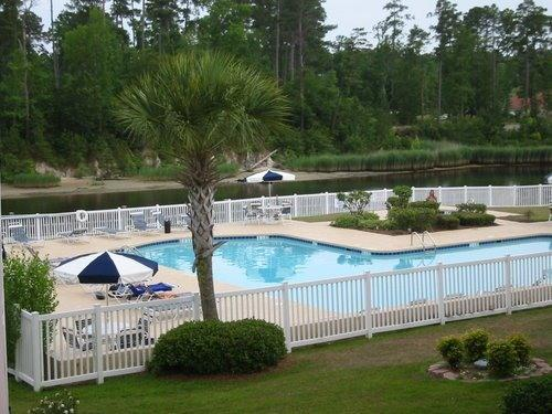 Partial view of large pool & hot tub on waterway - Myrtle Beach Clean Condo w/Pools near Beach & Golf - Myrtle Beach - rentals